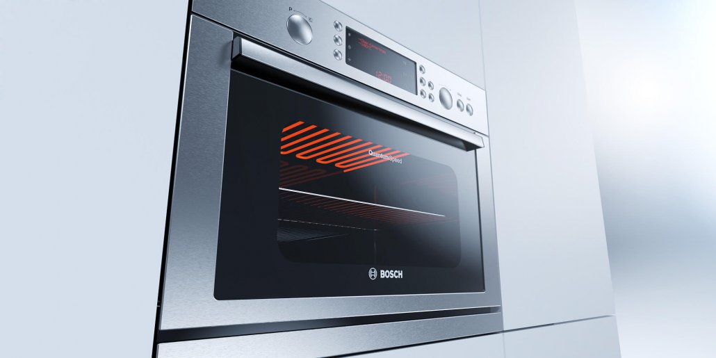 Bosch Einbauofen aus Edelstahl eingebaut in heller Küchenfront vor neutralem Hintergrund