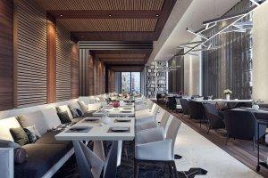Modernes Restaurant mit Sitzplätzen und langem Gang
